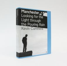 MANCHESTER: LOOKING FOR LIGHT THROUGH THE POURING RAIN